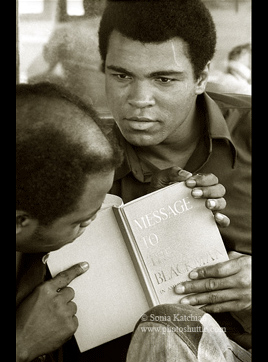 Muhammad Ali reading Message to the Blackman in America by Elijah Muhammad.